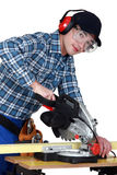Craftsman cutting wood. Craftsman cutting plank of wood Stock Photography