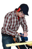 Craftsman cutting wood Stock Photos
