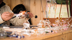 Craftsman decorating glass objects with a torch. Stock Photo
