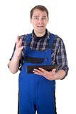 Craftsman with digital tablet in panic Royalty Free Stock Photo