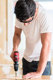 Craftsman or DIY man working with power drill Royalty Free Stock Photography