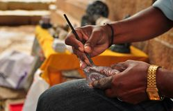 Craftsman doing stone carvings focus on hands Royalty Free Stock Photos