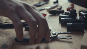Craftsman electrician working on wiring using pair of pliers to strip Stock Photography