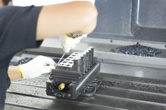 The craftsman filing. The work piece on the CNC machine Stock Photography