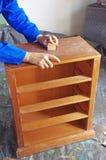 Craftsman grinding Royalty Free Stock Image