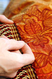 Craftsman hands working on. A curtain with a needle Royalty Free Stock Photos