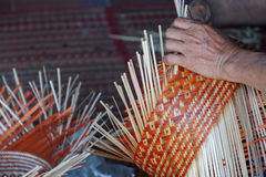 Craftsman hands working basketry Royalty Free Stock Photos