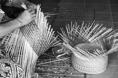 Craftsman hands working basketry Stock Photos