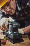 Craftsman with hard machine Royalty Free Stock Photography