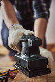 Craftsman with hard machine Stock Photography