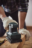 Craftsman with hard machine Stock Images