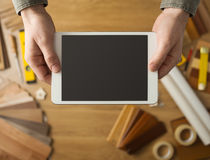 Craftsman holding a digital tablet Royalty Free Stock Images