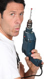 Craftsman holding a drill Stock Photo
