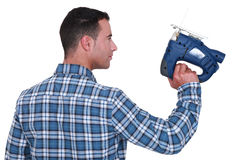 Craftsman holding a drill Stock Photography
