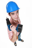 Craftsman holding a drill Royalty Free Stock Images