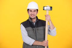 Craftsman holding a  hammer Stock Photography