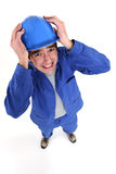 Craftsman holding his helmet Stock Images