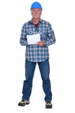 Craftsman holding paper Stock Photo