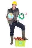 Craftsman holding a recycling label Royalty Free Stock Photo
