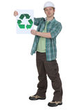 Craftsman holding a recycling label Stock Image