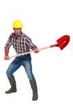 Craftsman holding a shovel Stock Images