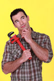 Craftsman holding a spanner Royalty Free Stock Photos