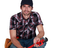 Craftsman holding a spanner Stock Photography