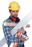Craftsman holding tools Stock Images