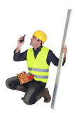 Craftsman holding a walkie talkie Stock Photography