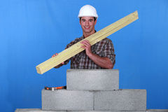 Craftsman holding wooden boards Stock Photography