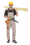 Craftsman holding wooden boards Royalty Free Stock Image