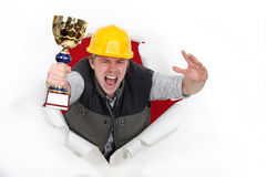 Craftsman holds trophy Royalty Free Stock Image