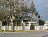 Craftsman House Front. The front view of a craftsman house on a quiet street stock images