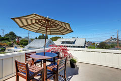 Craftsman house roof top terrace with living area. Table set with umbrella. Panorama of neighborhood. Northwest, USA Stock Image