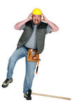 Craftsman hurting himself with hammer Stock Image