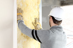 Craftsman insulating a wall Royalty Free Stock Photos