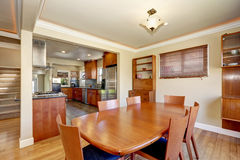 Craftsman kitchen and dining combo with soft beige walls Royalty Free Stock Photos