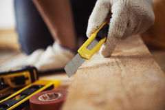 Craftsman with knife Royalty Free Stock Image