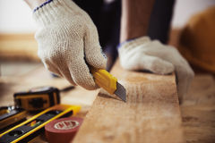 Craftsman with knife Royalty Free Stock Images