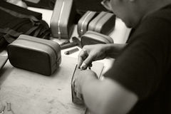 Craftsman. Leather man work with bag in film style Stock Images
