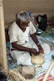 Cane Basket Craftsman. A craftsman makes cane basket in his handicraft workshop in India Stock Image