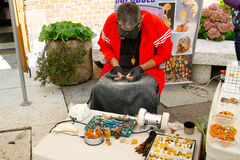 Craftsman makes and sells jewelry made of amber near Museum of Amber in Kaliningrad Stock Image