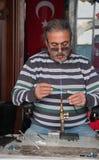 Craftsman makes souvenirs Royalty Free Stock Photo