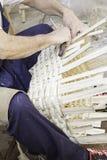 Craftsman making baskets Stock Image