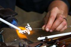 Craftsman making glass dog. Craftsman making glass dalmatian dog Stock Images