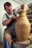 Craftsman making huge vase on pottery wheel Stock Photos