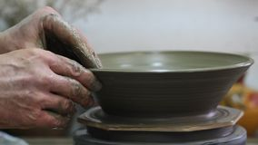 Craftsman making plate from clay stock video
