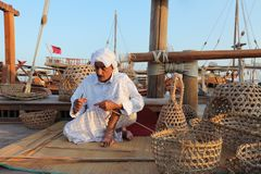 Craftsman making traditional fishing baskets royalty free stock photo
