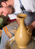 Craftsman Making Vase From Fresh Wet Clay Royalty Free Stock Images