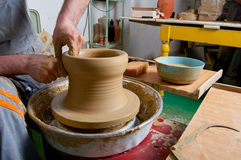 Craftsman making vase on the pottery wheel Stock Image